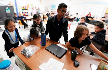 Fifth grade students move the teachers desk to blockade the classroom entrance door at Pinnacle Charter School during TAC*ONE training for an active shooter situation in a school in Thornton