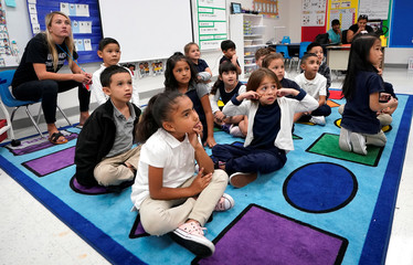 Kindergarten students at Pinnacle Charter School listen to an instructor during TAC*ONE training for an active shooter situation in a school in Thornton