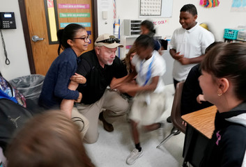 Joe Emery, TAC*ONE trainer and former Las Vegas police department sergeant, is swarmed by fifth grade students in a shooter take down exercise at Pinnacle Charter School during TAC*ONE training for an active shooter situation in a school in Thornton