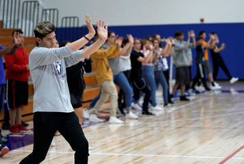 Pinnacle Charter School high school students practice self-defense moves during training for an active shooter situation in a school in Thornton