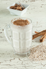 tasty and healthy oatmeal smoothie with cinnamon