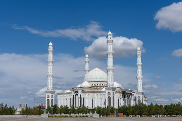 Hazret Sultan Mosque in the city of Nur Sultan. Beautiful white building of a mosque on a sunny day. Wall mural