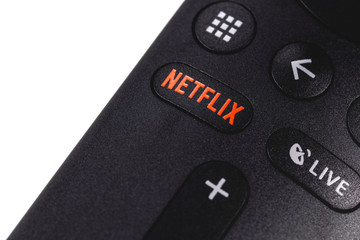Netflix button on the remote controller closeup. Netflix is an international leading subscription service for watching TV episodes and movies. Moscow, Russia - April 19, 2019