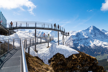 Traveller are resting and photograph on sky cliff walk at First peak of Alps mountain Grindelwald Switzerland