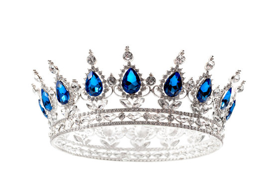 Beauty pageant winner, bride accessory in wedding and royal crown for a queen concept with a silver tiara covered diamonds and blue sapphire stones isolated on white with clipping path cutout