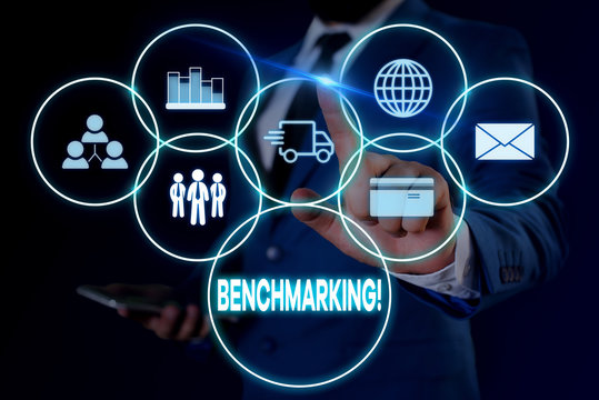 Text sign showing Benchmarking. Business photo showcasing evaluate something by comparison with standard or scores Male human wear formal work suit presenting presentation using smart device
