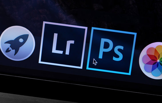 Apple Macbook with Adobe Photoshop and Lightroom icons app. Adobe Systems Incorporated is an American multinational computer software company. Moscow, Russia - May 10, 2019