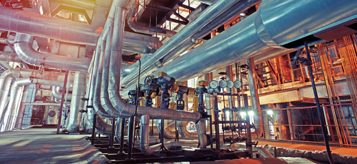 In de dag Planten Equipment, cables and piping as found inside of a modern industrial power plant