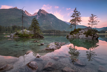 Scenin tranquil landscape with mountain, lake and sunset at summer evening in National park Berchtesgaden, Germany