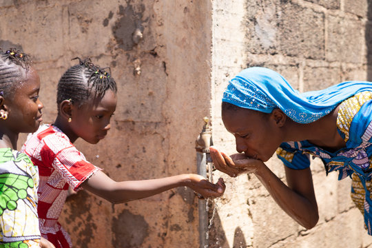 Water for African Children drinking fresh water outdoors