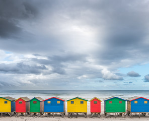 Multicolored cabins in a row on the beach at Muizenberg- South Africa