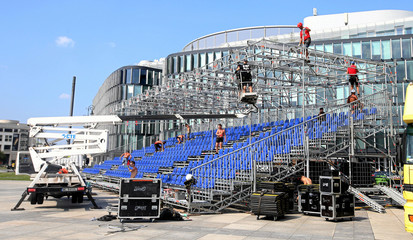 Workers build a stage for commemorative event to mark the beginning of WW2 in Warsaw