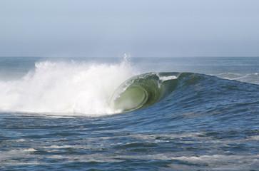 Large powerful barreling wave.