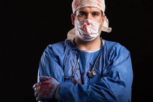 Portrait man in doctor costume for halloween with blood on his hands