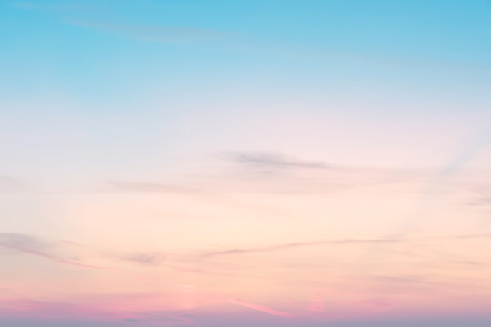 sunset background. sky with soft and blur pastel colored clouds.  gradient cloud on the beach resort. nature. sunrise.  peaceful morning. Instagram toned style