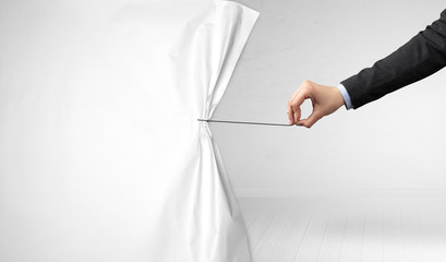 Fotomurales - hand pulling white paper curtain, changing scene concept