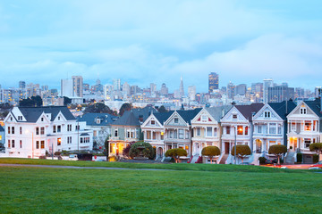 Traditional Victorian Houses at Alamo Square and downtown skyline, San Francisco, California, USA