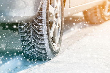 Close-up of car wheels rubber tires in deep winter snow. Transportation and safety concept. Wall mural