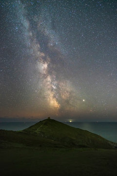 The Milky way shines in the summertime over the Rame Head Peninsula in Cornwall, UK