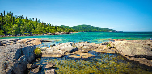 Aluminium Prints Blue Trees, rocks, forest and Lake on the Under the Volcano Trail along the beautiful rocky coast of Lake Superior at Neys Provincial Park, Ontario, Canada