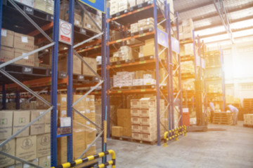 Blur Warehouse inventory product stock for logistic background, Long shelves with a variety of boxes (Lights background) Wall mural