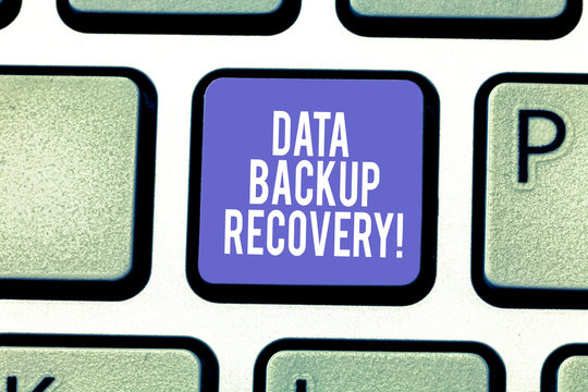 Word writing text Data Backup Recovery. Business concept for the process of backing up data in case of a loss Keyboard key Intention to create computer message pressing keypad idea