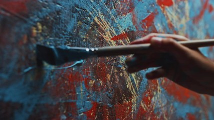 Fototapete - Close-up Shot of Female Artist Hand, Holding Paint Brush and Drawing Painting with Blue Paint. Colorful, Emotional Oil Painting. Contemporary Painter Creating Modern Abstract Piece of Fine Art