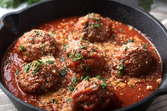 meatballs with tomato sauce in cast iron skillet