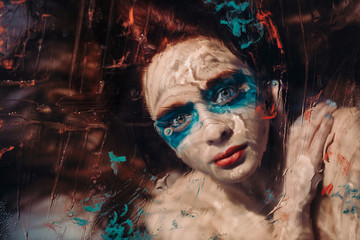 Garden Poster Body Paint Surreal portrait of red haired girl like a mermaid behind the glass with under water effects. asking for help