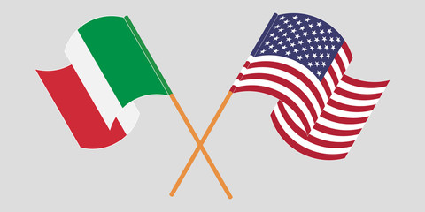 Crossed and waving flags of Italy and the USA