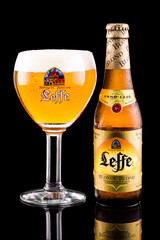 CHATHAM, NJ, USA - JULY 4, 2014: Leffe beer bottle and glass. Leffe is a beer brand owned by InBev Belgium marketed as Abbey beer.