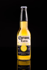 CHATHAM, NJ, USA - JUNE 30, 2014:  Corona Extra beer bottle. In the United States, Corona Extra is the top selling imported beer produced by  Constellation Brands in Mexico.