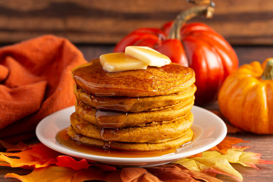 Stack of Pumpkin Spice Flavored Pancakes on a Wooden Table
