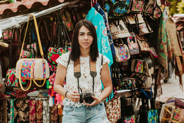 Hispanic girl Making pictures with travel camera in a Mexico trip, summer vacations in latin america