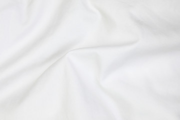 Fototapeta Close up of white bedding sheets soft focus and copy space