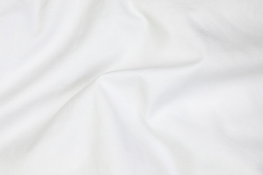 Close up of white bedding sheets soft focus and copy space