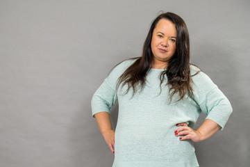 Plus size mature woman in jumper Papier Peint