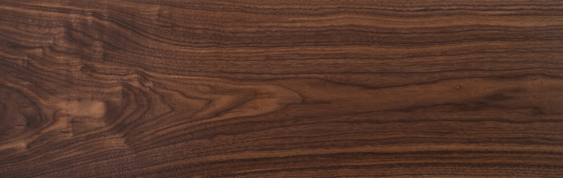 Texture of black walnut board with oil finish
