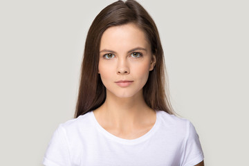 Headshot portrait of millennial young woman isolated in studio