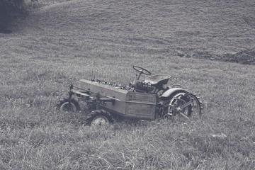 Fototapeta a old hay mower in a meadow