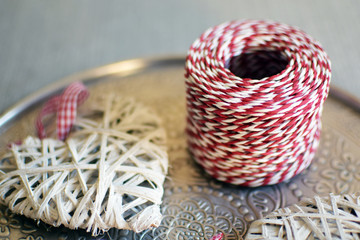 Christmas decorative red and white thread. Christmas decoration in close up. Red twine string roll