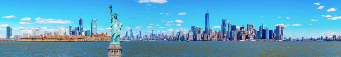 Panorama of The Statue of Liberty with the One world Trade building center over hudson river and...
