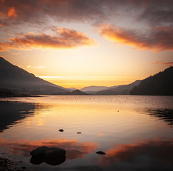 A square image of the winter sun setting over Loch Lubhair, Perthshire, Scotland