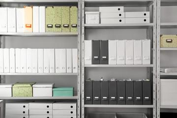 Fototapeta Folders with documents on shelves in archive obraz
