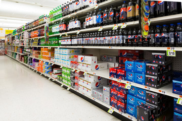 MADISON, NJ, UNITED STATES - FEBRUARY 13, 2014: Soft drinks aisle in an American supermarket. The affordability and wide variety of sugary drinks contribute to the growing obesity problem in the U.S.