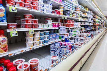 MADISON, NJ, USA - FEBRUARY 13, 2014: Cultured dairy products aisle in an American supermarket. Cultured milk products, known to mankind since antiquity, play an important role in the American diet