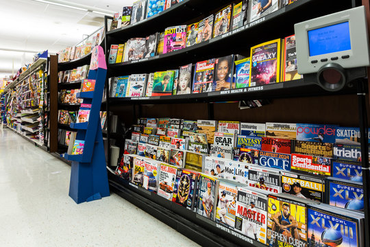 MADISON, NJ, UNITED STATES - FEBRUARY 13, 2014: Magazines aisle in an American supermarket. In the United States, the number of ad pages in magazines has dropped for three quarters in a row
