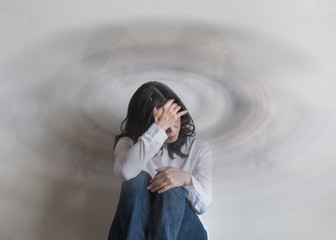 Vertigo illness with dizziness in woman patient feeling dizzy, faint with spinning movement inside head from benign paroxysmal positional vertigo (BPPV), migraine headaches, or hearing loss problem