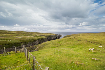 Tidal gorge Geodha Smoo which leads to Smoo Cave on the north coast of Scotland.