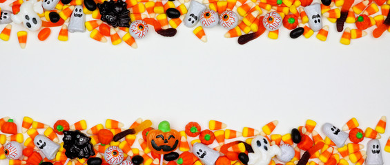 Halloween candy double border banner. Top view on a white background with copy space.